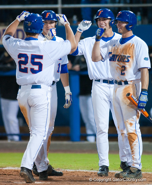 Teammates congratulate Preston Tucker after hitting his second home run in a row in the bottom of the sixth inning during the University of Florida 16-3 win against the University of Central Florida on 4/8/09         Photo by: Tim Darby