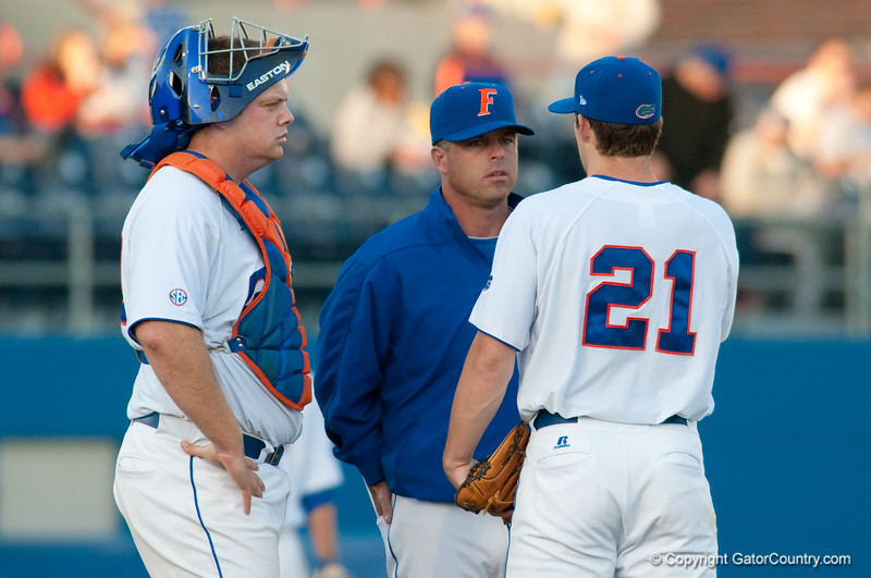 Kevin O'Sullivan has a meeting at the mound with Justin Poovey and Teddy Foster during the University of Florida 16-3 win against the University of Central Florida on 4/8/09         Photo by: Tim Darby