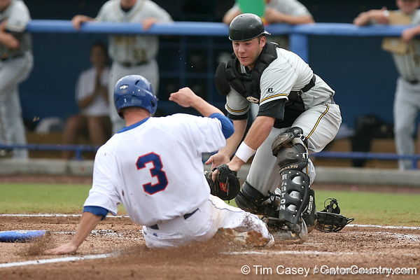 Florida senior Brandon McArthur is tagged out at home by Southern Mississippi catcher Travis Graves during the fourth inning of the Gators' 9-7 loss to the Golden Eagles in the NCAA Gainesville Super Regional on Saturday, June 6, 2009 at McKethan Stadium in Gainesville / Gator Country photo by Tim Casey