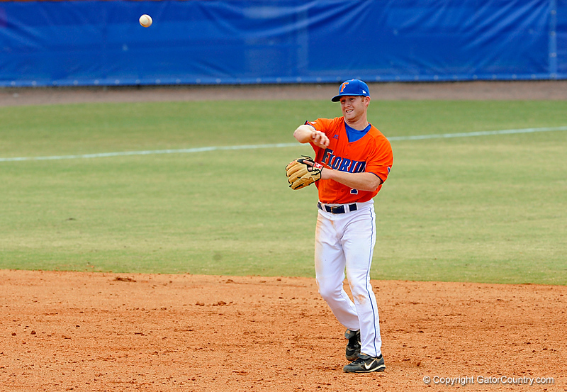 "(Casey Brooke Lawson / Gator Country) Tyler Thompson throws the ball during the University of Florida ""Meet the Team"" event for UF baseball on Saturday, February 14, 2009."