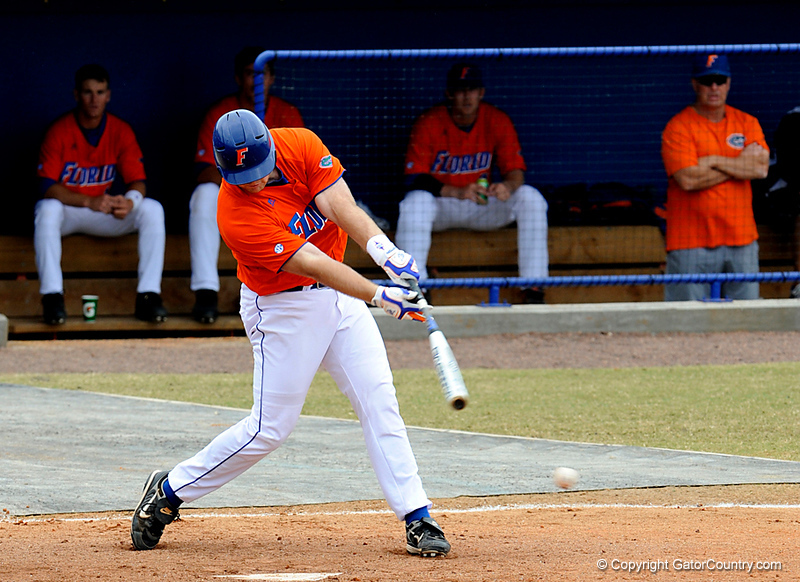 """(Casey Brooke Lawson / Gator Country) Teddy Foster swings during the University of Florida """"Meet the Team"""" event for UF baseball on Saturday, February 14, 2009."""