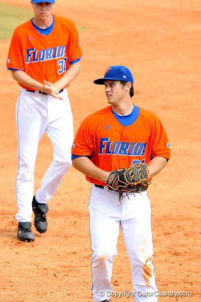 """(Casey Brooke Lawson / Gator Country) Kevin Chapman pauses and looks toward his coach during the University of Florida """"Meet the Team"""" event for UF baseball on Saturday, February 14, 2009."""