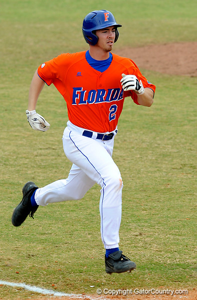 """(Casey Brooke Lawson / Gator Country) Josh Adams runs toward first base during the University of Florida """"Meet the Team"""" event for UF baseball on Saturday, February 14, 2009."""