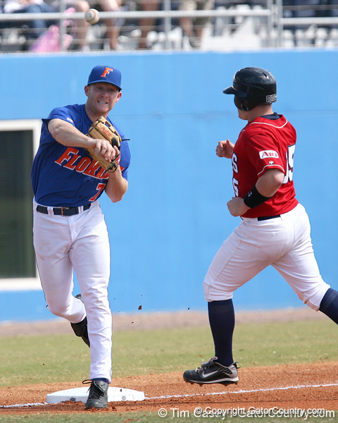 photo by Tim Casey<br /> <br /> Florida junior Clayton Pisani throws to first base after retiring Anthony Manley at third base on an unassisted fielder's choice during the first inning of the Gators' 12-2 win against the Duquesne Dukes on Sunday, March 8, 2009 at McKethan Stadium in Gainesville, Fla.