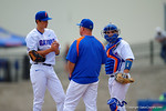 Florida Gators head coach Kevin O'Sullivan and catcher Mike Rivera come out in the second inning to calm down Florida Gators pitcher Dane Dunning.  Florida Gators vs Miami Hurricanes.  February 22nd, 2015. Gator Country photo by David Bowie.