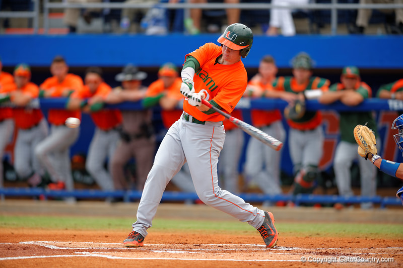 A Miami batter swings at a pitch during the second inning.  Florida Gators vs Miami Hurricanes.  February 22nd, 2015. Gator Country photo by David Bowie.