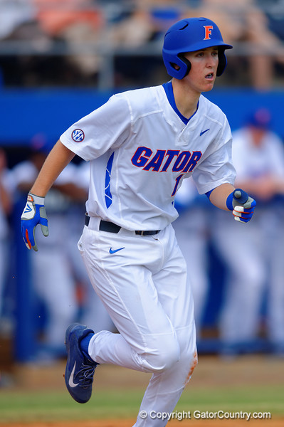 Florida Gators infielder Christian Hicks sprints down to first base during the third inning.  Florida Gators vs Miami Hurricanes.  February 22nd, 2015. Gator Country photo by David Bowie.