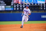 Florida Gators outfielder Harrison Bader swings and drives the ball over the left field wall to put the Gators up 2-1 in the fourth inning.  Florida Gators vs Miami Hurricanes.  February 22nd, 2015. Gator Country photo by David Bowie.