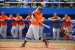 A Miami batter swings at a pitch in the fifth inning.  Florida Gators vs Miami Hurricanes.  February 22nd, 2015. Gator Country photo by David Bowie.