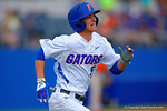 Florida Gators infielder Dalton Guthrie sprints down the first base line during the third inning.  Florida Gators vs Miami Hurricanes.  February 22nd, 2015. Gator Country photo by David Bowie.