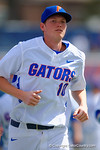 Florida Gators first baseman A.J. Puk runs into the dugout after finishing pre-game drills.  Florida Gators vs Miami Hurricanes.  February 22nd, 2015. Gator Country photo by David Bowie.
