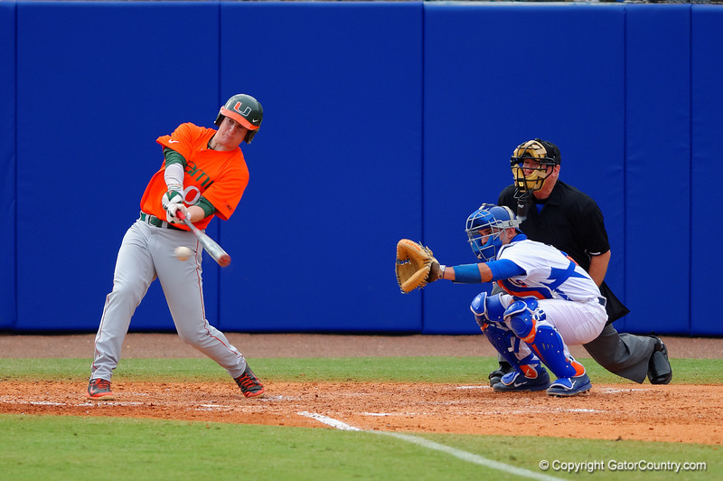 Miami Hurricanes Zach Collins singles in the eigth inning.  Florida Gators vs Miami Hurricanes.  February 22nd, 2015. Gator Country photo by David Bowie.