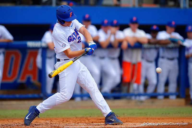 Florida Gators DH JJ Schwarz swings at a pitch during the second inning.  Florida Gators vs Miami Hurricanes.  February 22nd, 2015. Gator Country photo by David Bowie.
