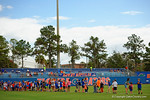 Kids attending the game wait to join the players on the field for the singing of the national anthem.  Florida Gators vs Miami Hurricanes.  February 22nd, 2015. Gator Country photo by David Bowie.
