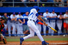 Florida Gators outfielder Buddy Reed singles in the third inning to bring in Gators infielder Christian Hicks to tie the game 1-1.  Florida Gators vs Miami Hurricanes.  February 22nd, 2015. Gator Country photo by David Bowie.