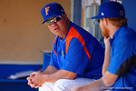 Florida Gators head coach Kevin O'Sullivan waits in the dugout prior to start of the game.  Florida Gators vs Miami Hurricanes.  February 22nd, 2015. Gator Country photo by David Bowie.