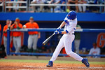 Florida Gators infielder Christian Hicks makes contact with a pitch in the fifth inning.  Florida Gators vs Miami Hurricanes.  February 22nd, 2015. Gator Country photo by David Bowie.
