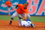 Miami Hurricanes infielder Zack Collins tags out a sliding Buddy Reed to end the third inning.  Florida Gators vs Miami Hurricanes.  February 22nd, 2015. Gator Country photo by David Bowie.
