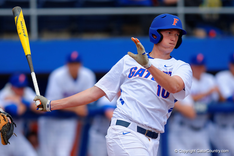 Florida Gators first baseman A.J. Puk swings and drives the ball for a double in the second inning.  Florida Gators vs Miami Hurricanes.  February 22nd, 2015. Gator Country photo by David Bowie.