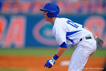 Florida Gators infielder Christian Hicks leads off from first base during the third inning.  Florida Gators vs Miami Hurricanes.  February 22nd, 2015. Gator Country photo by David Bowie.