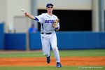 Florida Gators infielder Christian Hicks throws to first base for an out during the third inning.  Florida Gators vs Miami Hurricanes.  February 22nd, 2015. Gator Country photo by David Bowie.