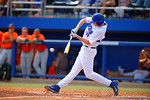 Florida Gators first baseman A.J. Puk swings and drives a pitch in the fourth inning.  Florida Gators vs Miami Hurricanes.  February 22nd, 2015. Gator Country photo by David Bowie.