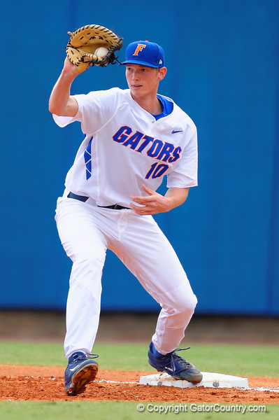 Florida Gators first baseman A.J. Puk catches the infield throw at first base for an out in the second inning.  Florida Gators vs Miami Hurricanes.  February 22nd, 2015. Gator Country photo by David Bowie.