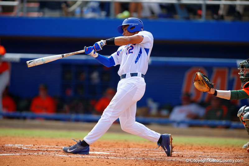 Florida Gators shortstop Richie Martin swings at a pitch in the fourth inning.  Florida Gators vs Miami Hurricanes.  February 22nd, 2015. Gator Country photo by David Bowie.