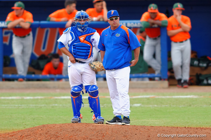 Florida Gators head coach Kevin O'Sullivan and Gators catcher Mike Rivera look to the bullpen in the eigth inning.  Florida Gators vs Miami Hurricanes.  February 22nd, 2015. Gator Country photo by David Bowie.