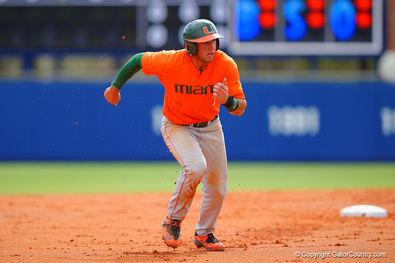 Miami Hurricanes infielder George Iskenderian sprints toward third base during the second inning.  Florida Gators vs Miami Hurricanes.  February 22nd, 2015. Gator Country photo by David Bowie.