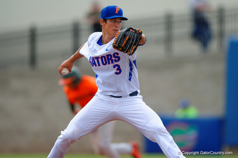 Florida Gators pitcher Dane Dunning delivers a pitch during the second inning.  Florida Gators vs Miami Hurricanes.  February 22nd, 2015. Gator Country photo by David Bowie.