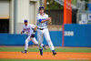 Florida Gators infielder Christian Hicks throws on the run to first base for an out during the fourth inning.  Florida Gators vs Miami Hurricanes.  February 22nd, 2015. Gator Country photo by David Bowie.