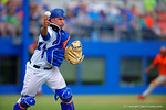 Florida Gators catcher Mike Rivera picks up the ground ball and throws to first base for an out in the third inning.  Florida Gators vs Miami Hurricanes.  February 22nd, 2015. Gator Country photo by David Bowie.