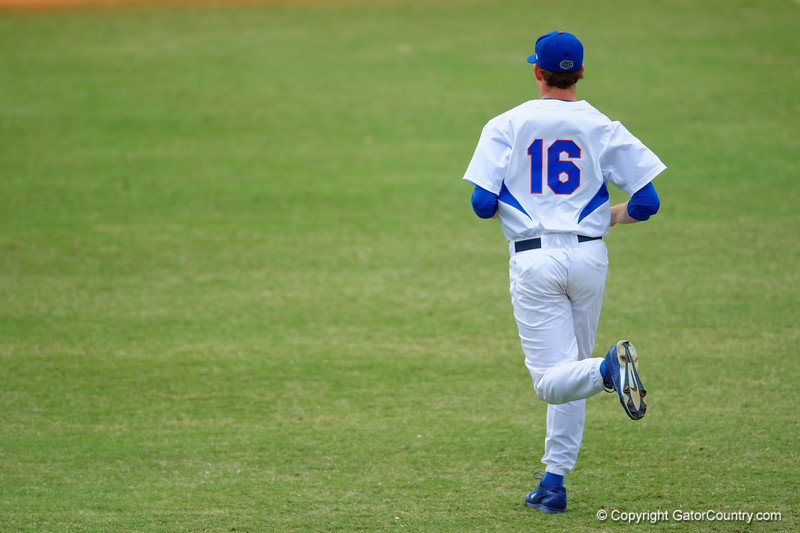 Florida Gators pitcher Taylor Lewis jogs in from the bullpen to takeover in the top of the eighth inning.  Florida Gators vs Miami Hurricanes.  February 22nd, 2015. Gator Country photo by David Bowie.