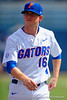 Florida Gators pitcher Taylor Lewis during pre-game drills.  Florida Gators vs Miami Hurricanes.  February 22nd, 2015. Gator Country photo by David Bowie.