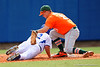 Florida Gators OF/LHP Logan Browning slides back to first base beating the tag by Miami Hurricanes first baseman David Thompson. Florida Gators vs Miami Hurricanes.  February 22nd, 2015. Gator Country photo by David Bowie.