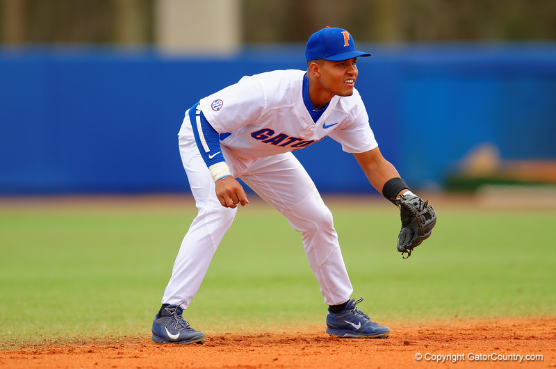 Florida Gators shortstop Richie Martin gets set for a pitch during the second inning.  Florida Gators vs Miami Hurricanes.  February 22nd, 2015. Gator Country photo by David Bowie.