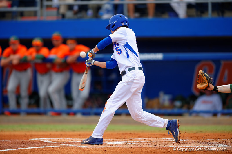 Florida Gators infielder Dalton Guthrie swings away at a pitch in the first inning.  Florida Gators vs Miami Hurricanes.  February 22nd, 2015. Gator Country photo by David Bowie.