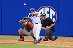 Florida Gators shortstop Richie Martin swings at a pitch in the eighth inning.  Florida Gators vs Miami Hurricanes.  February 22nd, 2015. Gator Country photo by David Bowie.