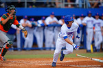 Florida Gators outfielder Logan Browning sprints down to first base following a hit in the third inning. Florida Gators vs Miami Hurricanes.  February 22nd, 2015. Gator Country photo by David Bowie.