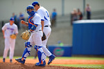 Florida Gators catcher Mike Rivera looks back to the dug out as he walks with Florida Gators pitcher Dane Dunning out to the mound in the fifth inning.  Florida Gators vs Miami Hurricanes.  February 22nd, 2015. Gator Country photo by David Bowie.