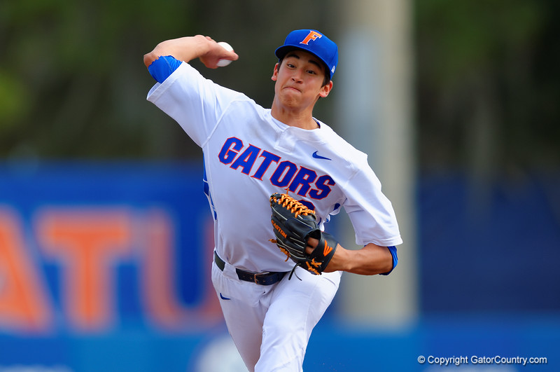 Florida Gators pitcher Dane Dunning delivers a pitch in the fourth inning.  Florida Gators vs Miami Hurricanes.  February 22nd, 2015. Gator Country photo by David Bowie.