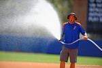 A Florida Gators prepare for the start of the game by watering the infield.  Florida Gators vs Miami Hurricanes.  February 22nd, 2015. Gator Country photo by David Bowie.