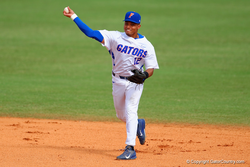 Florida Gators shortstop Richie Martin throws out a runner during the sixth inning.  Florida Gators vs Miami Hurricanes.  February 22nd, 2015. Gator Country photo by David Bowie.