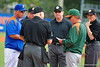 The two coaches meet at home plate before the game.  Florida Gators vs Miami Hurricanes.  February 22nd, 2015. Gator Country photo by David Bowie.