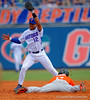 The throw to Florida Gators shortstop Richie Martin is to high and Miami Hurricanes outfielder Ricky Eusebio steals second base in the third inning.  Florida Gators vs Miami Hurricanes.  February 22nd, 2015. Gator Country photo by David Bowie.