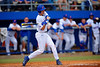 Florida Gators infielder Christian Hicks swings at a pitch in the seventh inning.  Florida Gators vs Miami Hurricanes.  February 22nd, 2015. Gator Country photo by David Bowie.