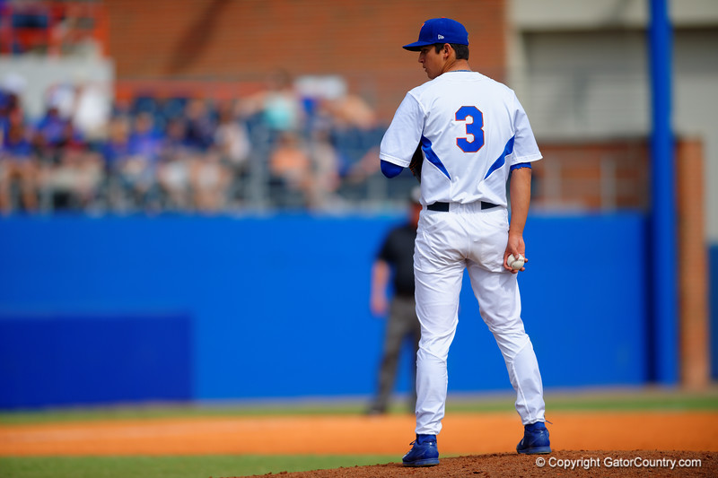 Florida Gators pitcher Dane Dunning looks to home for the pitch call in the fourth inning.  Florida Gators vs Miami Hurricanes.  February 22nd, 2015. Gator Country photo by David Bowie.