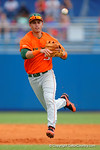 Miami Hurricanes shortstop Brandon Lopez throws the ball to first base for a ground out during the second inning.  Florida Gators vs Miami Hurricanes.  February 22nd, 2015. Gator Country photo by David Bowie.
