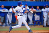 Florida Gators infielder Dalton Guthrie swings at a pitch during the seventh inning.  Florida Gators vs Miami Hurricanes.  February 22nd, 2015. Gator Country photo by David Bowie.